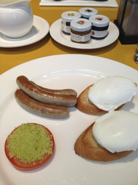 Poached eggs with sausages on the first morning.