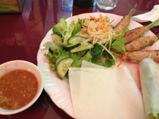 I was in Hue, Viet Nam in the early part of January on holiday.  Minced chicken wrapped around lemongrass and grilled.  Wrap in rice paper with veggies, dip in sauce and eat.  Vietnamese food is the best of all Asian food after Japanese if I may say so.