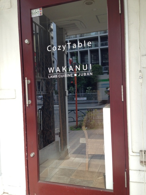 """The sign """"Cozy Table"""" is for the unrelated restaurant upstairs.  """"Wakanui"""" was our destination on the basement floor."""