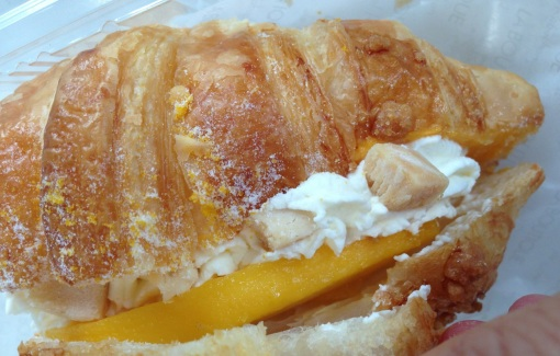 The pastry is filled with three kinds of cream: whipped, custard, and mango.