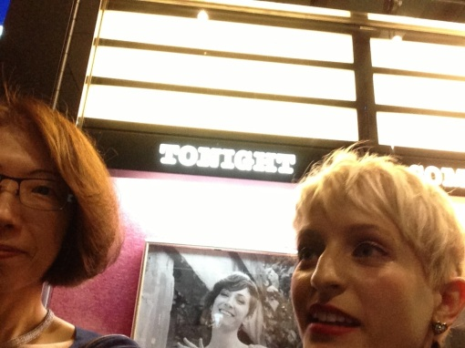 A two-some selfie in front of the Cotton Club sign.