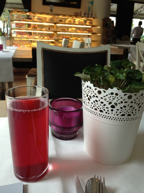 The red drink is a mixture of cooked fruits made into sort of a juice that came with the lunch menu.