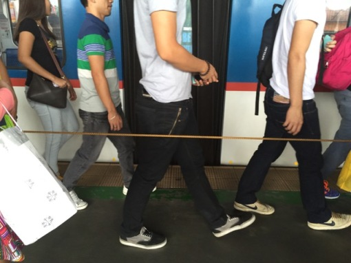 On the platform at Taft Avenue, the rope divides the passengers getting off and on the train.