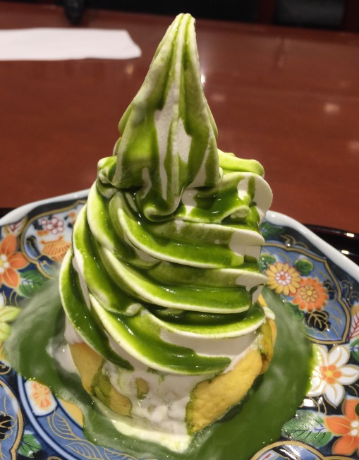 """The ice cream is good ol' """"milk"""" and it is glazed with a green tea sauce. On the bottom is a sweet potato cake with sweet red beans inside. The cake was a bit too dry which does not do justice to very good Japanese sweet potatoes."""