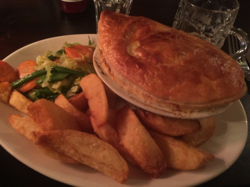 "Had one of their ""pies"" filled with beef cooked in ale. With chips."