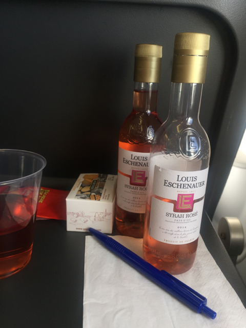 Buying drinks on board. Got the two-bottle deal ^^