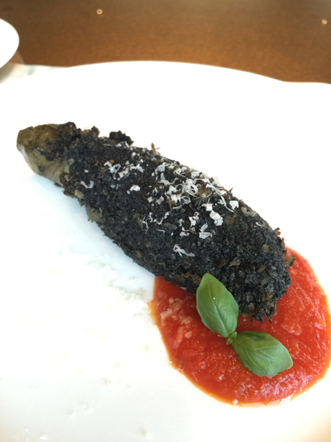 Steamed eggplant coated in Parmesan cheese that's been processed with charcoal (?!)