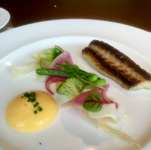 Roasted isaki (grunt) with sabayone sauce and spring vegetables