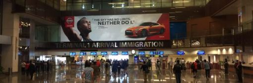 Arriving in Singapore. It's a 24-hour airport and immigration is busy but efficient at about midnight.
