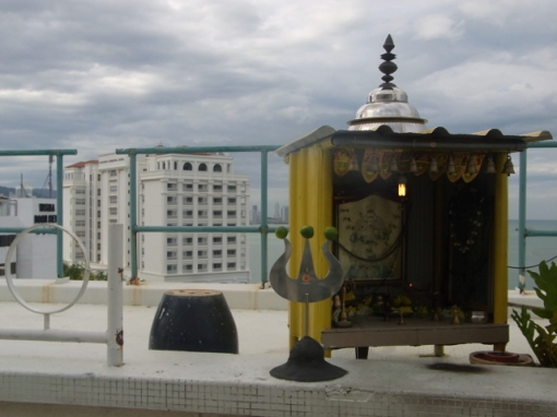 A little shrine at a rooftop bar!! There were three of these facing the same way.